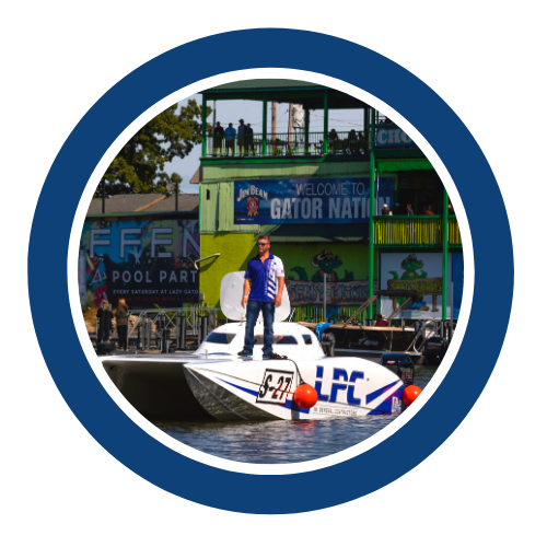 Man standing on white powerboat