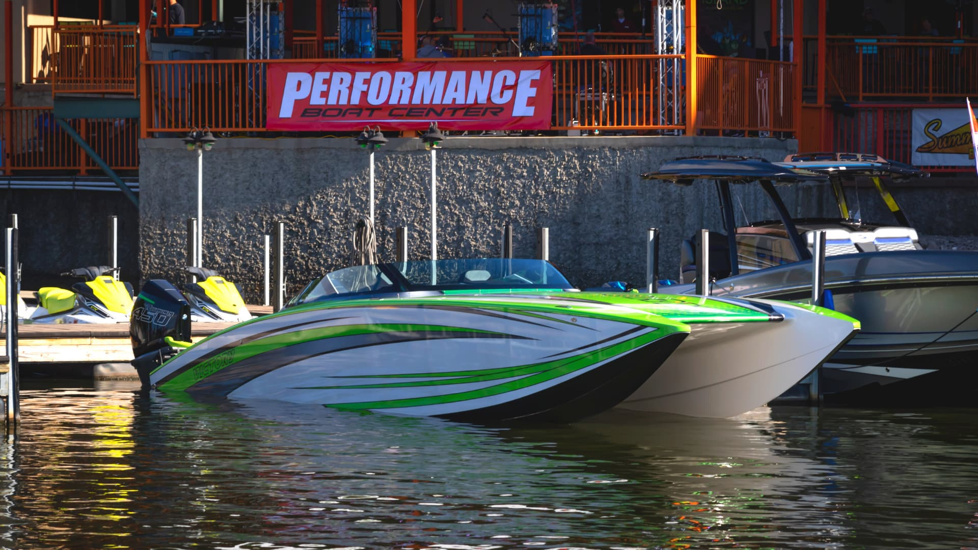 Green white and black powerboat